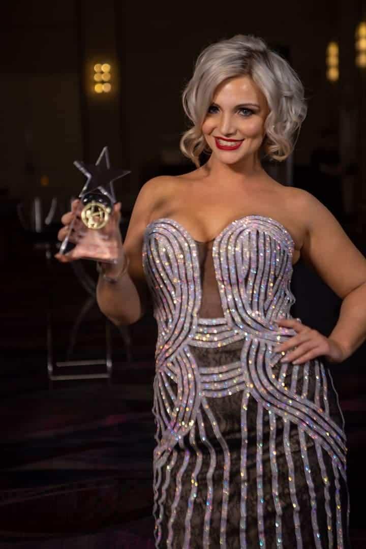 Taylor Hatfield posing with her Spirit Award at TSG2019