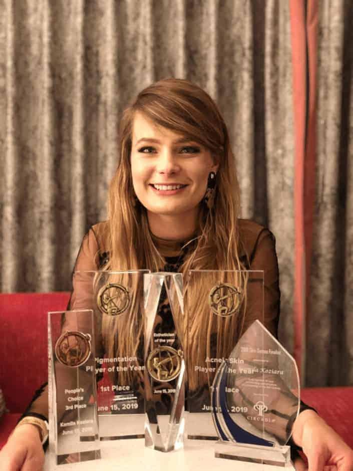 Kamila Koziara posing with all her trophies from TSG2019