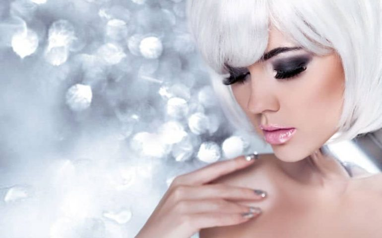 26205328 - fashion blond girl. beauty portrait woman. holiday make-up. snow queen high fashion portrait over blue bokeh background.